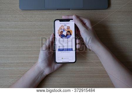 Chiang Mai, Thailand - Jun 22, 2020 : Female Touching Iphone With Linkedin Screen. Linkedin Helps Bu