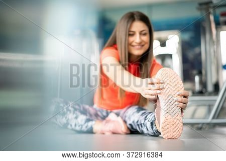 Pretty young woman cooling down in gym