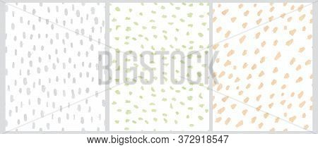 Cute Geometric Seamless Vector Patterns. Pastel Green, Yellow And Light Gray Free Hand Spatters Isol