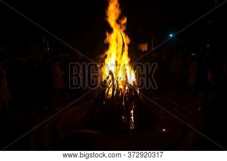 Giant Bon Fire Lit For The Festival Of Lohri Surrounded By People
