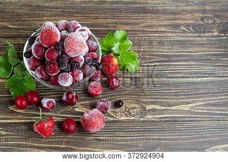 Frozen Fruits. Frozen Fruit Mixture Of Currants, Cherries And Strawberries. Vitamin Blend. On A Dark
