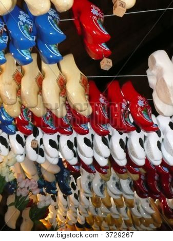 Rows of wooden shoes at at Netherland shoe factory. ** Note: Shallow depth of field poster