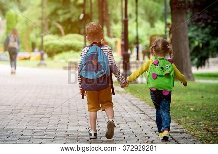 Child Going To School. Boy And Girl Holding Books And Pencils On The First School Day. Little Studen