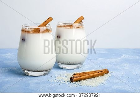 Homemade Traditional Mexican Or Spanish Cool Rice Horchata In A Glass On Blue Background. Fresh Cool