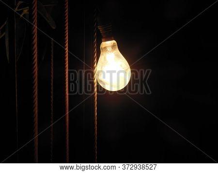 Electronic Light Bulbs 100 Watt Isolated On Black Background.