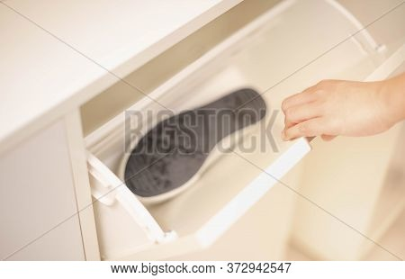 Female Opening The White Wood Shoes Cabinet For Keep The Shoes In The Wood Shoe Cabinet With New Int