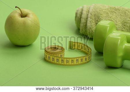 Healthy Regime Equipment, Defocused. Dumbbells In Bright Green Color