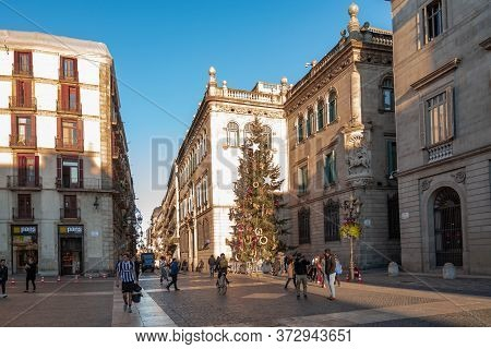 Barcelona, Spain - December 19, 2018: People Walk In Front Of The Generalitat Palace Of Catalonia In
