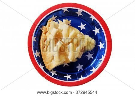 Apple Pie. Fresh Baked Apple Pie. Isolated on white. Lattice top Apple Pie. Whole Fresh Baked Pie on an American Flag design Paper Plate.