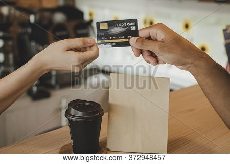 Hand Customer Paying With Credit Card For Buying Hot Coffee Cup On Counter In Modern Cafe Coffee Sho