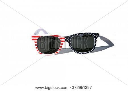 Fashion Sunglasses. American Flag Sunglasses. Isolated on white. Room for text. Fun Holiday Costume Sunglasses. American Flag Fashion Sunglasses.
