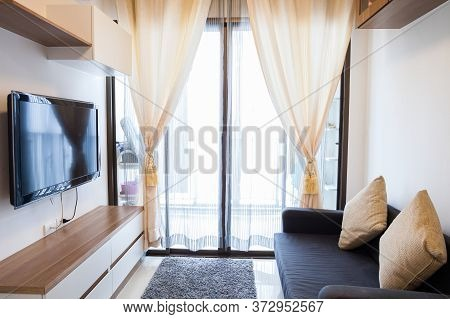 Modern Condominium Living Room And Bedroom At Daytime