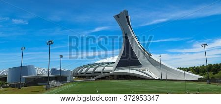 MONTREAL, CANADA- AOUT 10, 2018:  Olympic Stadium for 1976 Games and Biodome, one of four facilities that make part of the largest natural science museum complex  in Montreal, Canada.