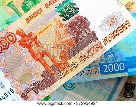 Russian Banknotes Are Hanging In The Air. The View From The Top. In The Foreground - The Banknote Of