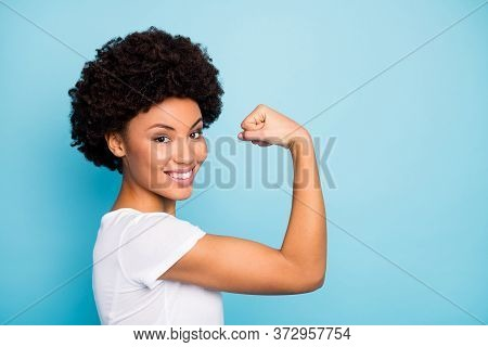 Closeup Profile Photo Of Beautiful Dark Skin Curly Lady Showing Perfect Shape Biceps After Intense T