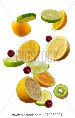 Falling Fresh Mixed Citruses. Slices Of The Lemon, Kiwi, Cherry,and Lime The Air. Flying Fruits Conc