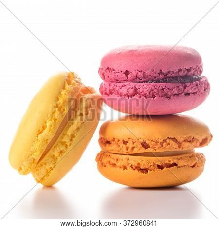 Three Delicious Piled Macaroons On White Background.