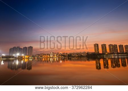 A Condominium Is Reflection On Water Under Colorful Sky At Sunset Timing Located At Impact Arina Ban