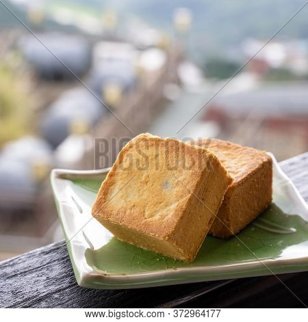 Delicious Pineapple Pastry In A Plate For Afternoon Tea On Wooden Railing Of A Teahouse In Taiwan Wi