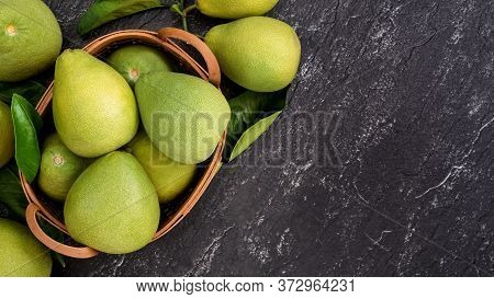 Fresh Pomelo, Pummelo, Grapefruit, Shaddock On Black Background, Fruit For Mid-autumn Festival, Top