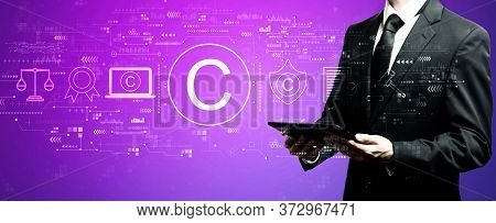 Copyright Concept With Businessman Using His Tablet Computer