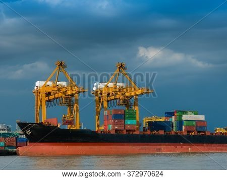 Photo Of Shipping Of Maritime Transportation Are Under Arrange Big Container Loading In The Big Boat