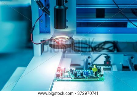 Robotic vision sensor camera system in intellegence pcb factory,manufacturing industry for industry 4.0 and technology concept