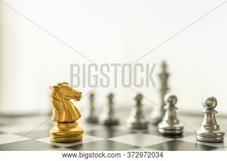 Sport Board Game, Business And Planning Concept. Closeup Of Knight Gold Chess Pieces Face To Face Wi