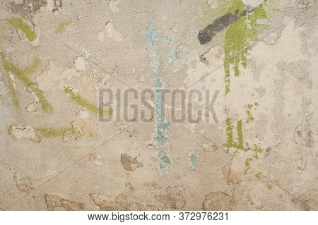 Distressed Yellow Brown Old Brick Wall With Graffiti Street Art. Rough Background And Wide Texture.