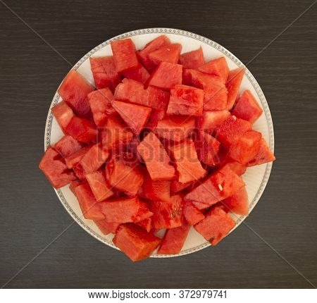 Close - Up Of A Few Slices Of Refreshing Ripe Watermelon On A Plate. Raw Organic Fruits Vegetables.