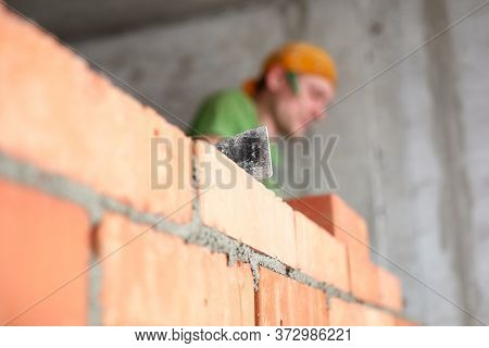 Close-up Detail Smooth Brickwork, Mason Work. Stack Red Bricks. Brick Used Construction Walls. Durat