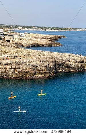 Polignano A Mare, Italy - September 17, 2019: People Are Swimming Along The Cliff In Polignano A Mar