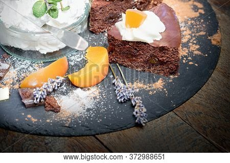 Creamy Chocolate Cake With Apricot, Apricot Jam - Marmalade And Whipped Cream In Glass Bowl