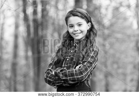 Already Into Fashion. Happy Child Keep Arms Crossed Outdoors. Fashion Look Of Vogue Model. Small Gir