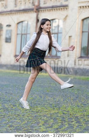 Excited About Holidays. Happy Child Celebrate Holidays Outdoors. Energetic Girl Marching In School U