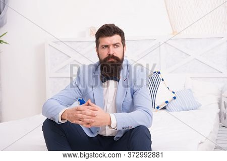On Wedding Anniversary. Bearded Man In Wedding Style Sit On Bed. Hipster Wait In Wedding Suite. Form