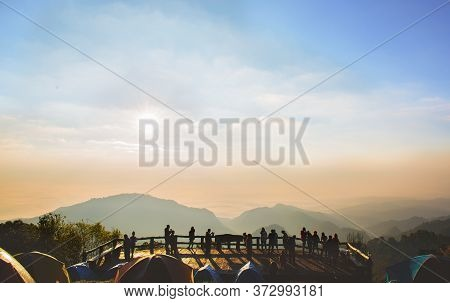Perspective Beautiful Moutain View With Crowded Silhouette People At Doi Ang Khang - Chaing Mai , Th