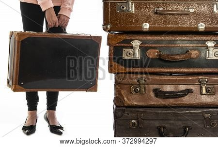 Young Girl With An Old Suitcase Isolated On A White Background