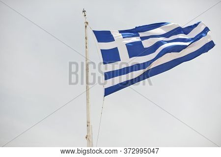 June 2018, Greece - Flag Of Greece Is Developing In The Wind Against The Sky.
