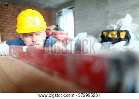 Close Up Of Male Worker In Gloves And Yellow Helmet Working In Manufactured Joinery Workshop