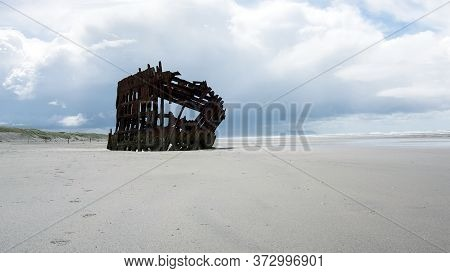 View Of The Shipwreck Of Peter Iredale At A Beach In Warrenton, Oregon, Usa. This Four-masted Steel
