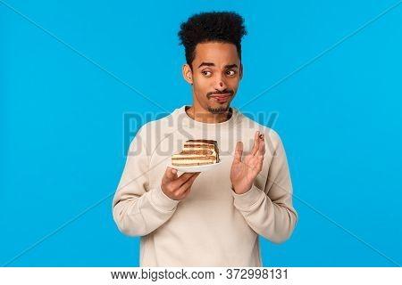 Guy Tried Biting Cake Didnt Like Taste. Displeased And Unimpressed Skeptical, Picky African-american