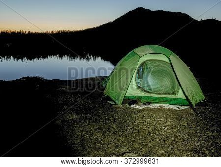 Sunrise By Green Tent Set In The Sierra Nevada Overlooking Island Lake, California, Featuring The Ru