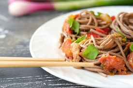 Japanese Buckwheat Noodle Soba With Vegetables, Chicken Meat, Soy Sauce And Greens. Healthy Japanese