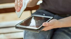 Guy Wipes Tablet With Napkin. Cleaning The Tablet.