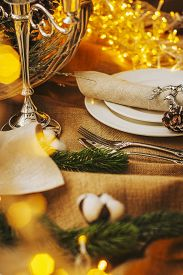 Christmas Table Setting. New Year's Decor: Fir Cones And Branches, Cotton Balls, A Garland And Silve