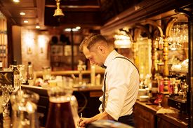 Vladivostok, Russia - July 7, 2019: Barman At Work In A Retro Restaurant In The Gangster Style Of Ch