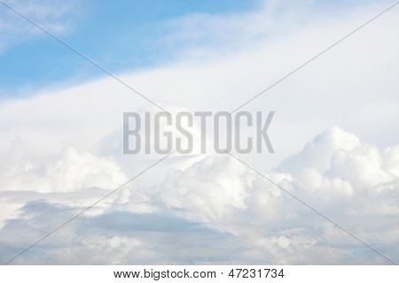 light blue sky with white clouds formation