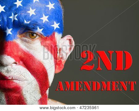 Man's Face Painted With the  Flag Uof the USA, and 2nd Amendment