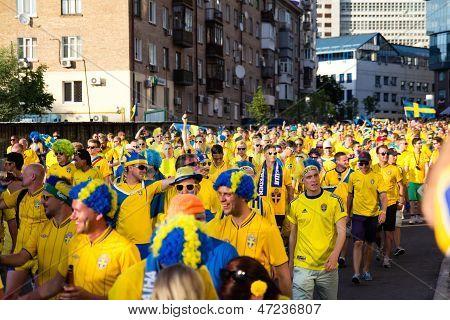 Kiev, Ukraine - June 11: Cheering Sweden Fans Go To Stadium Before Match Euro 2012 On June 11, 2012